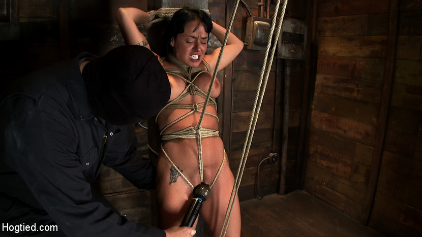 BestBDSM24.com - Image 14445 - Hot sexy Hawaiian is bound to a pole, lifted to her tip toes with a brutal crotch rope. Made to cum!