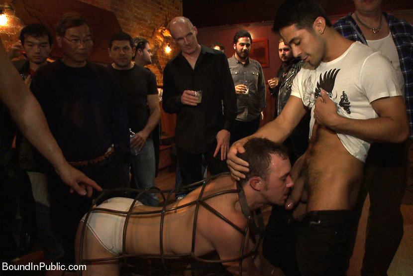 BestBDSM24.com - Image 28286 - Stud in a metal cage is fucked by horny bar patrons