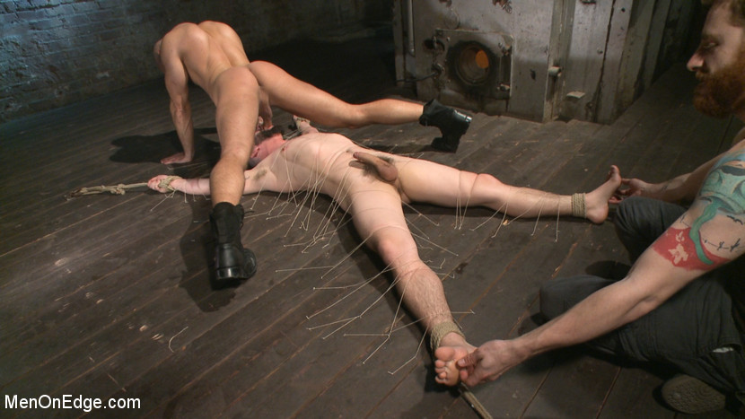 BestBDSM24.com - Image 37398 - Suspended in a center split, helpless uncut stud blows a huge load!